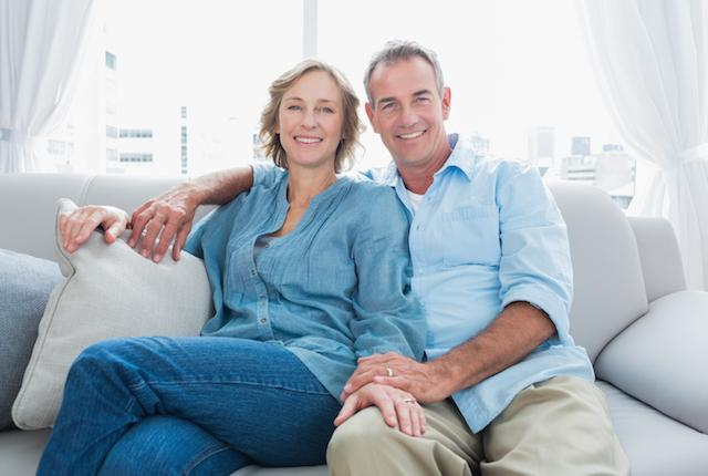 Older Couple on Couch | Clinton Township Dental Implants
